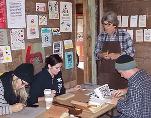 John Steins teaches a workshop on traditional hand wood block carving and printing.