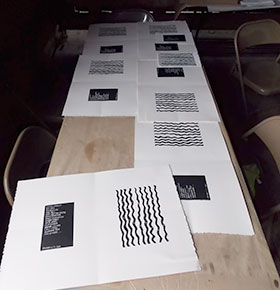 The ink dries on the handcrafted covers of the Patina Overhang journal by Amy Ball and Elif Saydamat the 3rd Dawson Daily News Print and Publishing Symposium