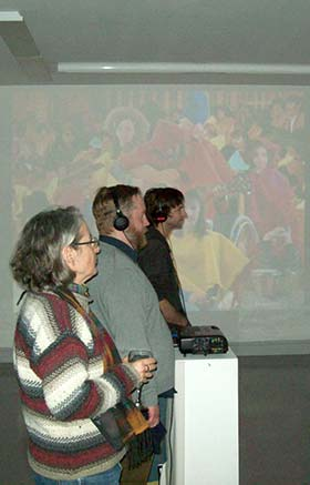 Audience members take in one of the video installations during the opening of the 2015 Cold Cuts Video Festival at the Dawson Film Fest