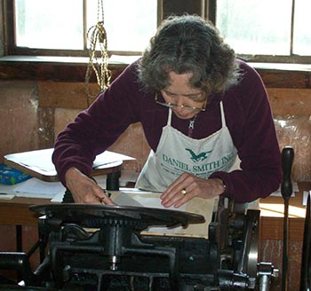 Jan Elsted of Barbarian Press adjusts a plate in the Symposium's vintage Chandler & Price Letterpress.