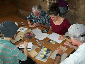 Attendees of the Wood Block Printing workshop try their hand at cutting their own printing blocks.