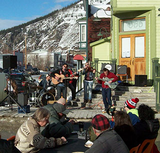 Local band Corn plays before the pierogie eaters during the DCISFF's Easter Sunday Street party.