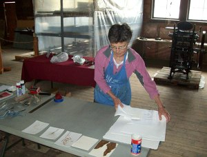 Claire Kujundzic prepares materials for her collography workshop.