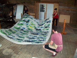 Michael MacLean (foreground) looks on at finished Mountain Landscape Pattern