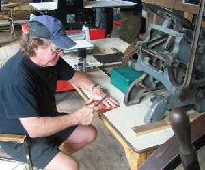 Master printer Peter Braune prepares a copper plate for engraving.